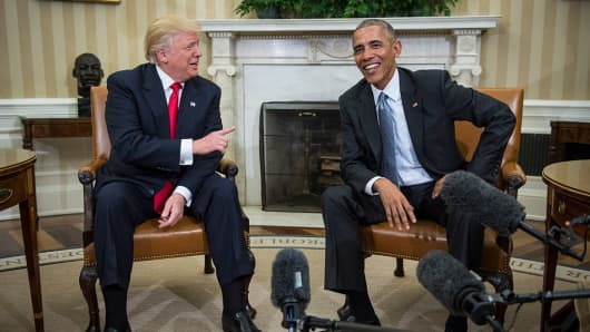 President Barack Obama shakes talks with President-elect Donald Trump in the Oval Office of the White House in Washington, Thursday, Nov. 10, 2016.