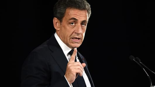 Nicolas Sarkozy, former French president and candidate for the right-wing Les Republicains (LR) party primary ahead of the 2017 presidential election, gestures as he delivers a speech during a public meeting in Nimes on November 18, 2016.