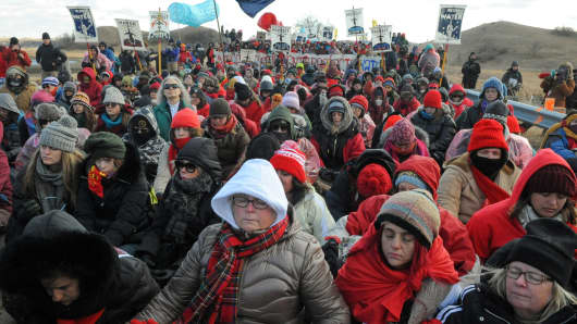 Protesters sit in silence during a protest against plans to pass the Dakota Access pipeline near the Standing Rock Indian Reservation, near Cannon Ball, North Dakota, U.S., November 18, 2016.