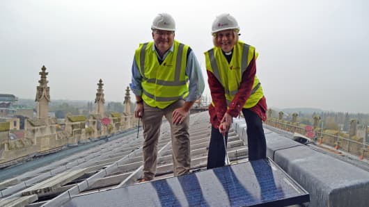 Canon Celia Thomson bolts in the first solar panel on top of Gloucester Cathedral, in south west England.