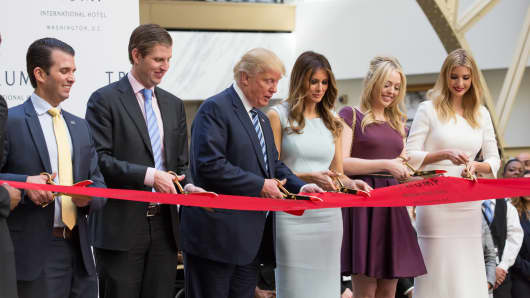n the grand lobby of Trump international Hotel, (l-r), Donald Trump Jr., Eric Trump, U.S. Presidential candidate Donald J. Trump, Melania Trump, Tiffany Trump, and Ivanka Trump, cut the ribbon for their latest property, Trump International Hotel - Old Post Office, in Washington, DC on October 26, 2016.