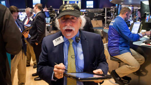 A trader wears a hat that reads 'DOW 19,000' on the floor of the New York Stock Exchange (NYSE) in New York, U.S., on Monday, Nov. 21, 2016.