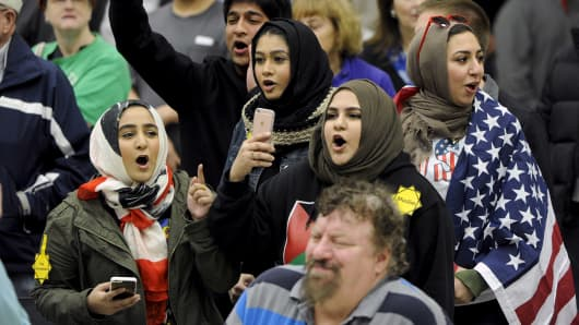 Young Muslims protest U.S. Republican presidential candidate Donald Trump before being escorted out during a campaign rally in the Kansas Republican Caucus at the Century II Convention and Entertainment Center in Wichita, Kansas March 5, 2016.