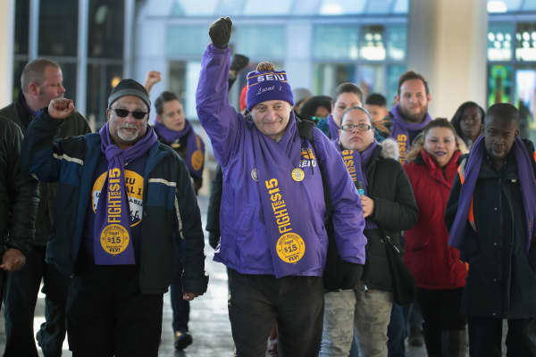 Workers and SEIU representatives leave a press conference at O'Hare Airport on November 21, 2016 in Chicago, Illinois.