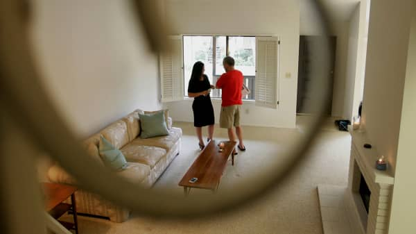 A realtor speaks with a potential homebuyer during an open house in Arcadia, California.