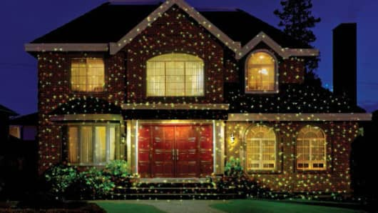 a home decorated with star shower lights - Home Depot Black Friday Christmas Decorations