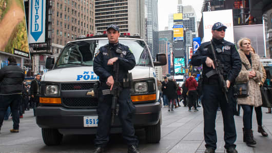 Heavily armed NYPD counterterrorism officers stand at post near the entrance to the restricted zone between 42nd and 43rd Streets. (file photo).