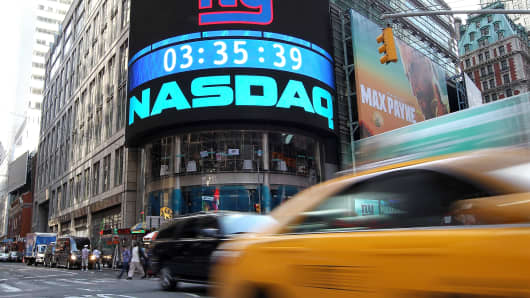Cars drive by the Nasdaq headquarters in New York City.