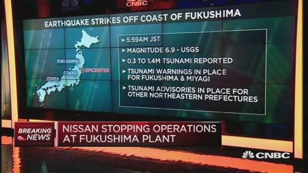 Japan markets open slightly down after earthquake