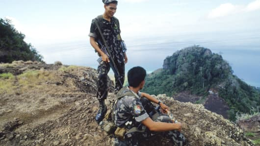 Philippine marines keep a look out for pirates in the Sulu Sea.