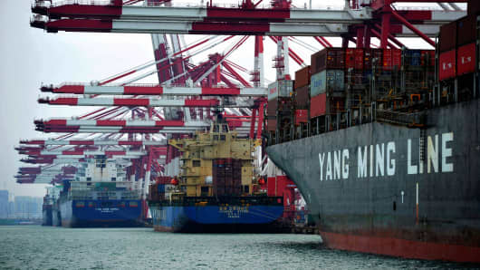 Cargo ships berth at a port in Qingdao, east China's Shandong province.