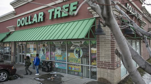 Pedestrians walk past a Dollar Tree Inc. store in Detroit, Michigan, U.S.