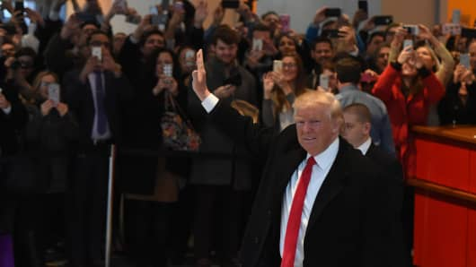 President-elect Donald Trump waves to the crowd after leaving a meeting at the New York Times on November 22, 2016 in New York.