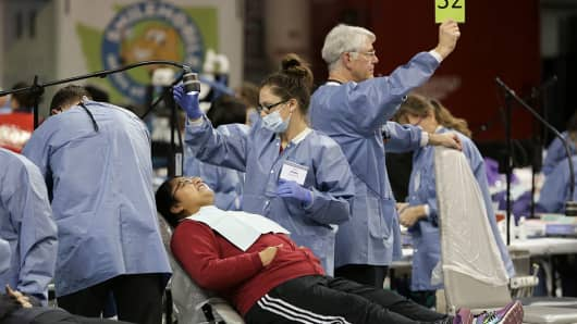 A patient gets dental care during the Seattle/King County Clinic at the Key Arena in Seattle, Washington on October 28, 2016.