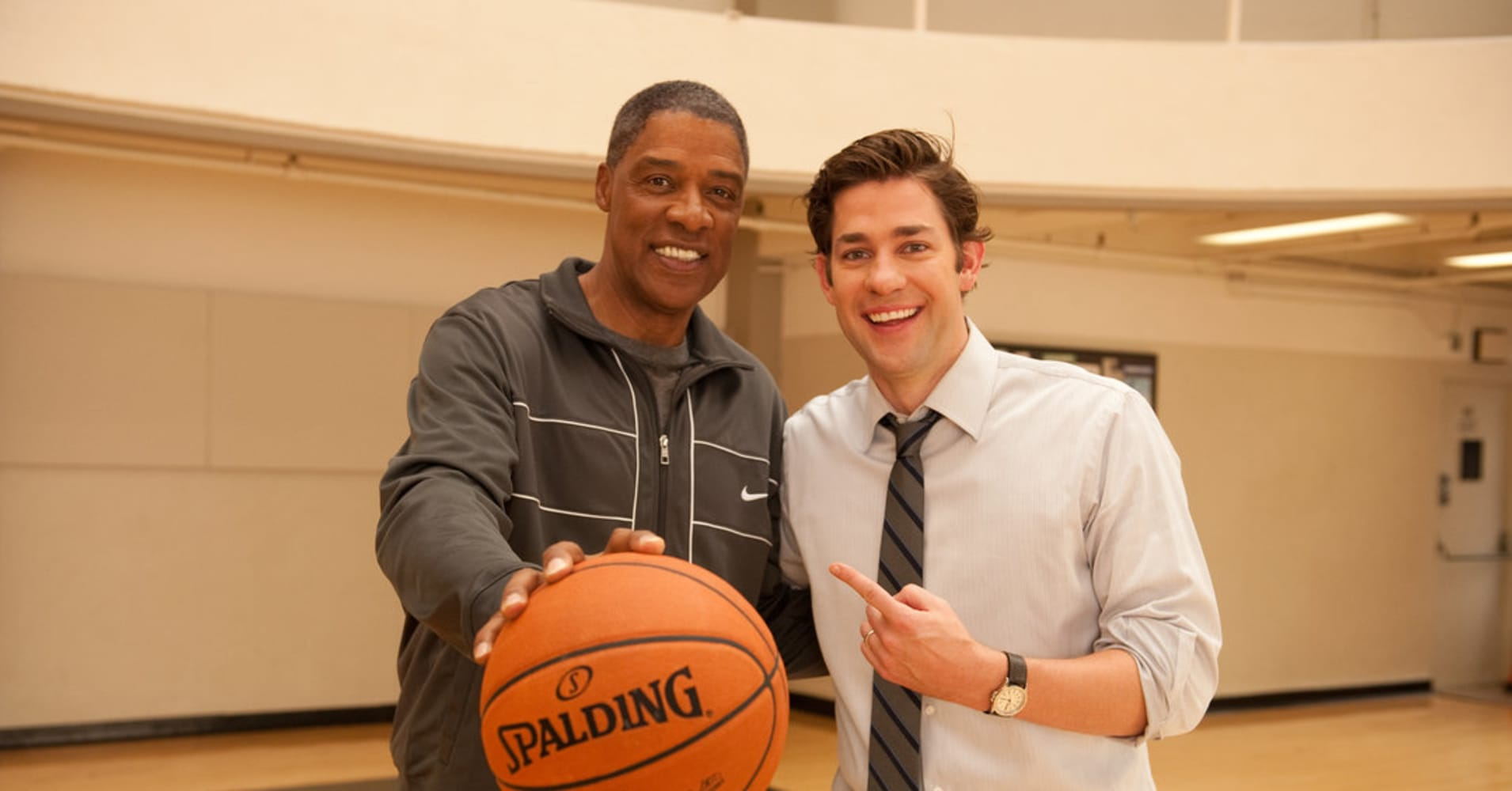 "Jim Halpert, from NBC Universal's ""The Office,"" is an incredibly likeable co-worker. In this image, he poses with basketball legend Julius Erving."