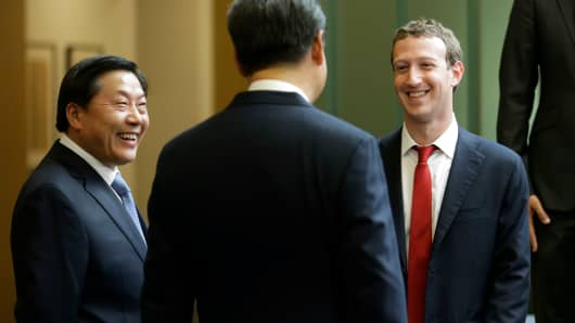 In this Wednesday, Sept. 23, 2015, file photo, Chinese President Xi Jinping, center, talks with Facebook Chief Executive Mark Zuckerberg, right, as Lu Wei, left, China's Internet czar, looks on during a gathering of CEOs and other executives at Microsoft's main campus in Redmond, Wash.