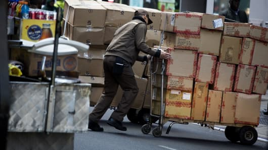 A United Parcel Service Inc. (UPS) driver delivers packages on Cyber Monday in New York, U.S., on Monday, Nov. 30, 2015.