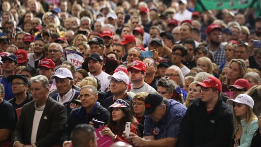 People listen as Republican Presidential candidate Donald Trump speaks at a rally on October 22, 2016 in Cleveland, Ohio.