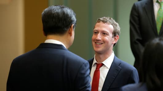 Chinese President Xi Jinping, left, talks with Facebook Chief Executive Mark Zuckerberg.