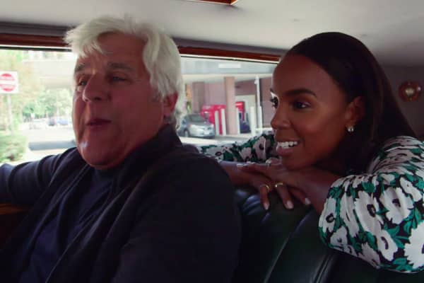 Singer and songwriter Kelly Rowland and Jay Leno drive around in a 1931 8-liter Bentley Mulliner.