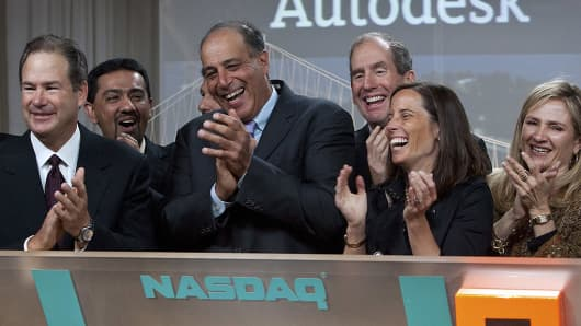 Carl Bass, president and chief executive officer of Autodesk Inc., center, takes part in ringing the Nasdaq opening bell remotely with Adena Friedman, chief financial officer of NASDAQ OMX Group, second from right, at the Autodesk office in San Francisco, California, U.S., on Thursday, June 24, 2010.