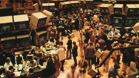 Traders on the floor at the New York Stock Exchange, New York City, USA, 2nd June 1981.