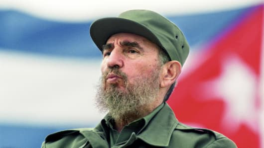 Fidel Castro observes the May Day parade at the Revolution Square in Havana, Cuba May 1, 1998.