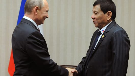 Russian President Vladimir Putin (L) meets with his Philippines' counterpart Rodrigo Duterte on the sidelines of the Asia-Pacific Economic Cooperation Summit (APEC)