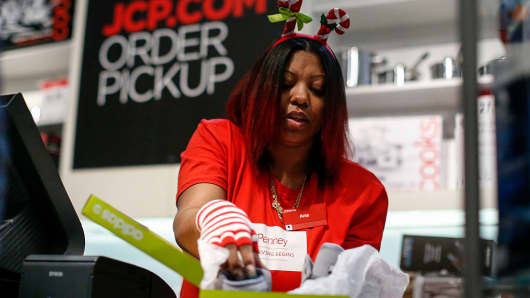 A JCpenny employee works at a cashier station at the Newport Mall