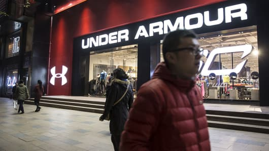 Pedestrians walk past an Under Armour Inc. store in Shanghai, China, on Monday, Dec. 21, 2015.