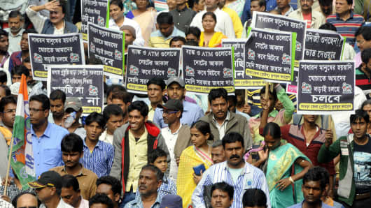 Supporters of The All India Trinamool Congress during a rally against demonetization of the Rs.500 and RS.1000 notes  on November 28, 2016 in Kolkata.