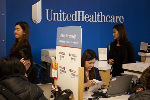 Representatives speak with customers at a UnitedHealthcare location in Queens, New York.