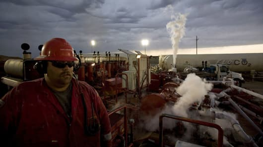 An employee of Halliburton Company monitors a series of