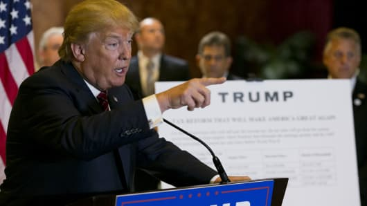 Republican presidential hopeful Donald Trump announces his tax plan during a press conference at Trump Tower in New York on September 28, 2015.