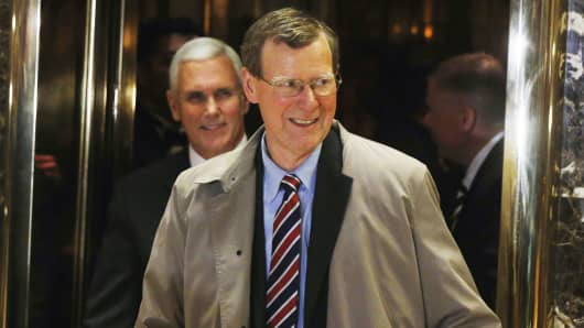John Allison, center, a former chief executive of BB&T Corp, departs with Vice President-elect Mike Pence after a meeting with President elect Donald Trump at Trump Tower New York, November 28, 2016.