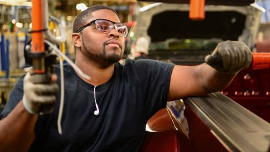 Brandon Malone assembles a Ford truck at the Louisville Ford truck plant in Louisville, Kentucky.