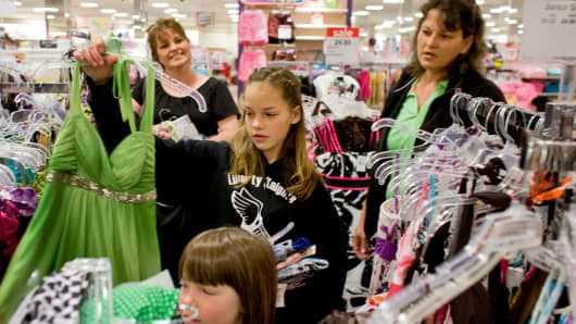 A mom, right, shopping with her daughters at a JC Penney store in Aurora, Colorado.