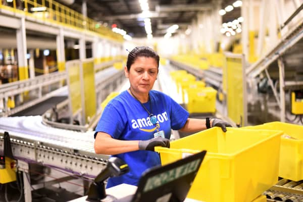 Maria Calhoun audits outgoing shipments at an Amazon Fulfillment Center in Tracy, California.
