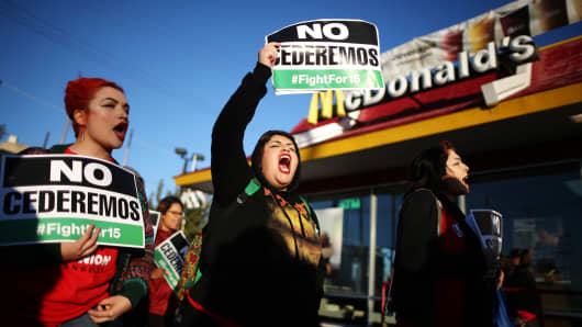 Protesters call for a minimum wage of $15 an hour during a demonstration in Los Angeles, California, November 29, 2016.