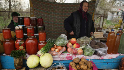 Vendors sell vegetables, birch bark juice, jam and other preserves on April 9, 2016, in Demydiv, Ukraine. Demydiv is south of the Chernobyl nuclear power plant, whose reactor number four exploded on April 26, 1986, in the world's worst civilian nuclear accident.