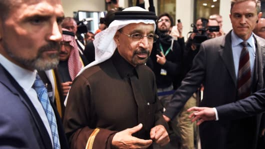 Khalid Al-Falih, Saudi Arabia's energy and industry minister, centre, departs following the 171st Organization of Petroleum Exporting Countries (OPEC) meeting in Vienna, Austria, on Wednesday, Nov. 30, 2016.