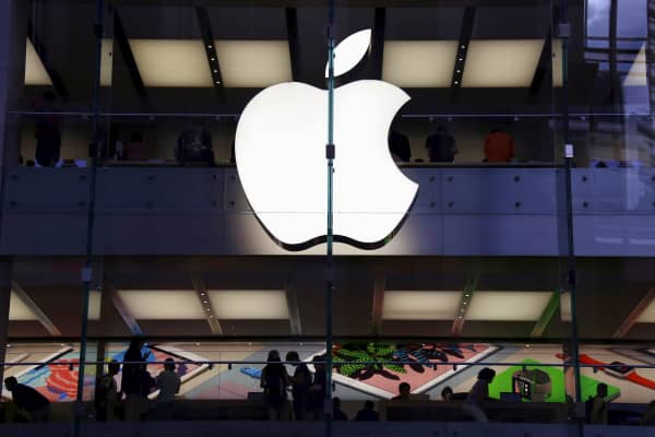 Customers can be seen inside the Apple store in central Sydney, Australia
