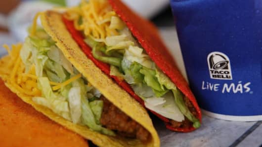 Doritos Locos tacos and a fountain drink are arranged for a photograph at a Taco Bell restaurant, a unit of Yum! Brands.