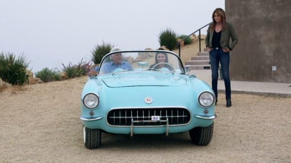 Caitlyn Jenner watches as her daughter Kendall goes for a classic car joy ride with Jay Leno.