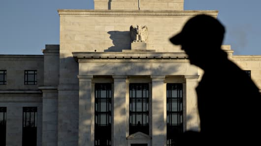 A runner passes the Marriner S. Eccles Federal Reserve Board building in Washington.