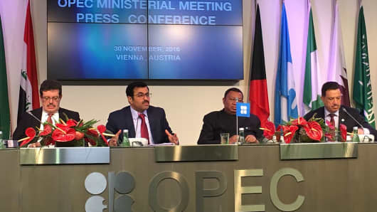 Qatar's Minister of Energy and the OPEC Conference President, Mohammed Bin Saleh Al-Sada (2nd L) and Secretary General of OPEC, Mohammad Sanusi Barkindo (2nd R) attend a press conference following the 171st Organization of Petroleum Exporting Countries (OPEC) meeting in Vienna, Austria on November 30, 2016.