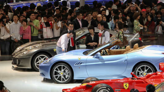 People crowd the exhibition area of auto companies during the 2009 Auto Shanghai at the Shanghai New International Expo Center on April 26, 2009 in Shanghai, China.