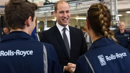 Britain's Prince William, Duke of Cambridge meets apprentices during a visit to the Rolls Royce factory in Derby, central England