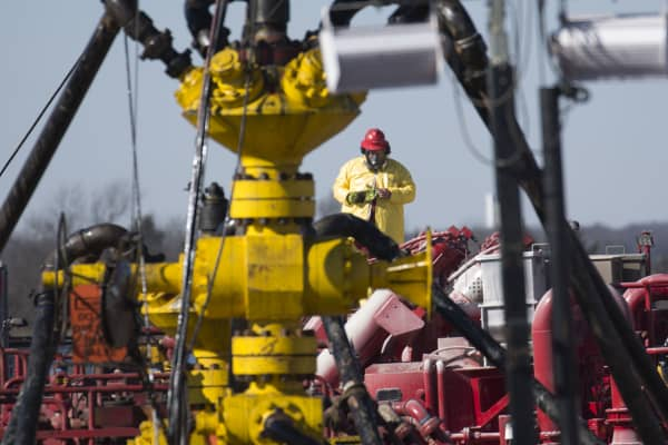 A Halliburton oil well fielder works on a well head at a fracking rig site January 27, 2016 near Stillwater, Oklahoma.