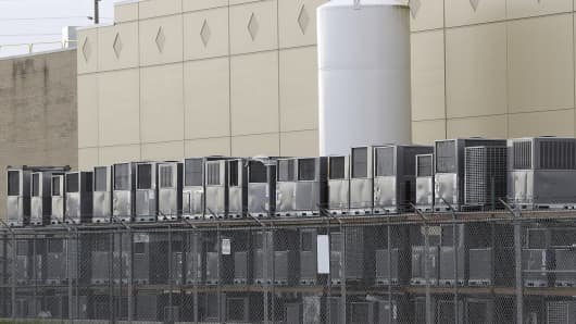 Air conditioning units are stacked outside the Carrier Corp. plant, Wednesday, Nov. 30, 2016, in Indianapolis. Carrier and President-elect Donald Trump reached an agreement to keep nearly 1,000 jobs in Indiana.